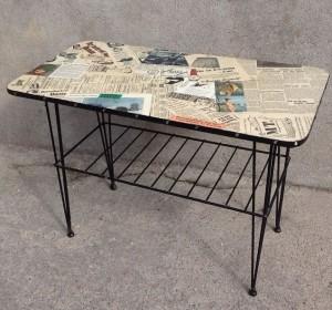 Soffbord (skivan kunde ej räddas) tapetserad med tidningsurklipp från 40/50-talet, lackad och försedd med nitad läderkant